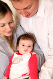 Young family with a baby. Royalty Free Stock Image