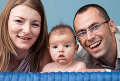 Young family with baby boy Stock Images