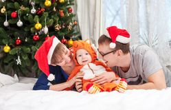 Young family with baby boy dressed in fox costume Stock Images