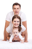 Young family with baby boy over white Royalty Free Stock Image
