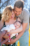 Young family and the baby girl Royalty Free Stock Image