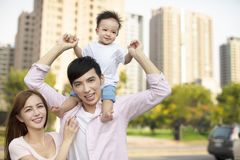 family with baby having fun in city park royalty free stock photography