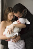 Young family with the baby at home Royalty Free Stock Photos