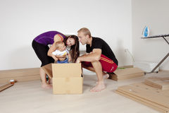 Young Family with a Baby  Moving Stock Photo