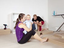 Young Family with a Baby  Moving Stock Images
