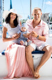 Young family with a baby on a sailing boat Stock Images