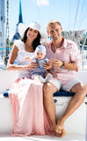 Young family with a baby on a sailing boat Royalty Free Stock Photos
