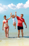 Young family on the beach Stock Image