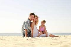 Young family on the beach Stock Images