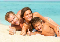 Young Family at the Beach Royalty Free Stock Photo