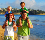 Young family at the beach in the morning Royalty Free Stock Photo