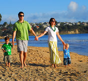 Young family at the beach in the morning Stock Photo