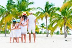 Young family on beach vacation in palm grove Stock Photography