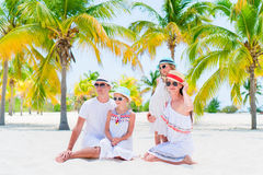 Young family on beach vacation in palm grove Royalty Free Stock Photography