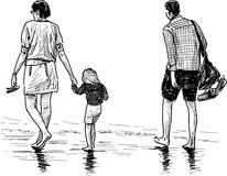 Young family on a beach Royalty Free Stock Photo