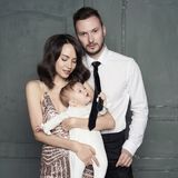 Young family with beautiful little baby in thair arms stock photos