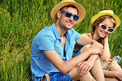 Young family. Beautiful young people in love enjoy their summer picnic Stock Image