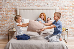 Young family being playful at home Royalty Free Stock Images