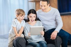 Young family being surprised by the video stock photography