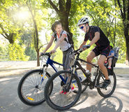 Young family on bicycles riding. Young family bike trip. riding Royalty Free Stock Photography