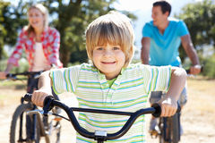 Young family on bike ride through country Royalty Free Stock Photography