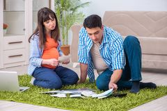 The young family in budget planning concept stock photo