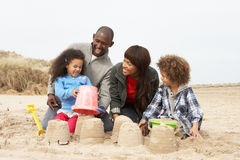 Young Family Building Sandcastle On Beach Holiday Royalty Free Stock Photo