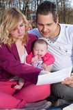 Young family is busy with paying bills Stock Image
