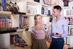 Young family buying sex toys together in store Stock Photography