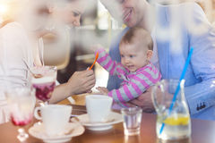 Young family in cafe Stock Photo