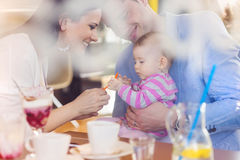 Young family in cafe Royalty Free Stock Image