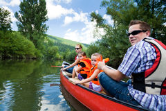 Young Family Canoeing Stock Photos
