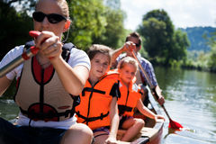 Young Family Canoeing Stock Photography
