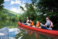 Young Family Canoeing Royalty Free Stock Photos