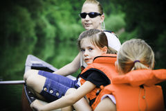Young Family Canoeing Royalty Free Stock Photography