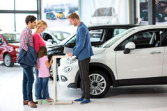 Young family with car dealer Royalty Free Stock Photography