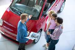 Young family in  the car dealership  saloon Stock Photography