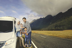 Young family with car in the mountain Royalty Free Stock Images