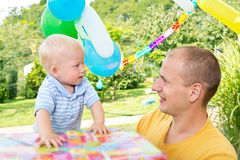 Young family celebrated birthday Royalty Free Stock Images