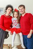 The young family celebrates New year. Happy parents with little daughter in a relaxed family atmosphere in the New year Royalty Free Stock Photos