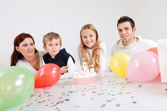 Young family celebrating birthday at home Stock Photos