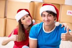 The young family celebrating christmas in new home royalty free stock photography