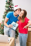 The young family celebrating christmas in new home stock images