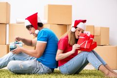 The young family celebrating christmas in new home stock photo