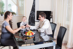 Young family celebrating at home Stock Images