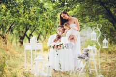 Young family with child at a picnic. Father, mother and daughter together at the picnic in the garden Royalty Free Stock Photos