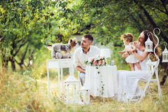 Young family with child at a picnic. Father, mother and daughter together at the picnic in the garden Stock Photo