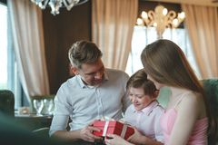 Young family with child in a restaurant Royalty Free Stock Images