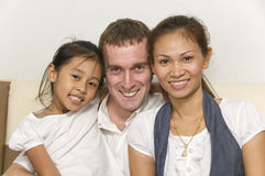 Young family with child smiling Stock Photography