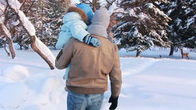 Young family with a child walking along a path stock video footage